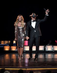 Faith Hill Photos Photos - Recording artists Faith Hill (L) and Tim McGraw perform onstage during the 52nd Academy Of Country Music Awards at T-Mobile Arena on April 2, 2017 in Las Vegas, Nevada. - 52nd Academy of Country Music Awards - Show