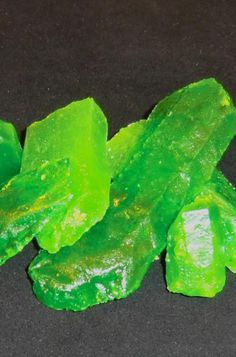 "Recipe For Kryptonite Candy - Just in time for the release of ""Man of Steel"", we here at STL Cooks have discovered the ULTIMATE candy for anyone who is a huge Superman fan...Kryptonite candy! Not only does it look like the stuff from the movies, it also glows under UV lights, and if done right; in regular light too!"