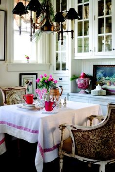 Just some sprigs of evergreen and candy canes add a festive touch to this breakfast room....via coffeepearlsandpoetry