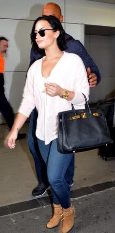 Demi Lovato arriving at an airport in Sydney, Australia - August 8th
