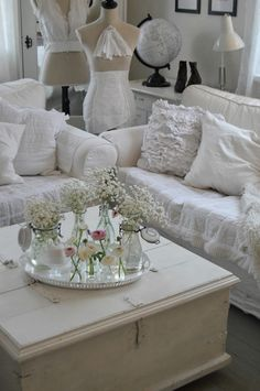 ~ hagbacken.blogspot.se ~ Gorgeous ruffly pillows and slipcovers!!!  Sweet little flowers.  Lovely