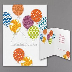There is no shortage of pretty patterns here; colorful balloons wear them on both the front and inside of this festive birthday card!