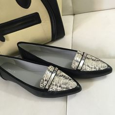 Calivn Klein Belicia Black with Snakeskin Flats Gorgeous black with snakeskin accent flats. Painted toe and sliver accent with Calvin Klein logo. Super cute and fashionable! Will also fit 9.5. Brand new, no box, leather. Ships in 24 hours, no trades, posh sales only  Calvin Klein Shoes Flats & Loafers