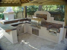 Extraordinary Outdoor Stainless Steel Kitchen Cabinet Design Inspiration In Outdoor U-Shaped Kitchen Decor Layout Features Light Wood Pergola And Ceramic Tiles Worktop Kitchen Island And Grill Also Single Sink As Well As Outdoor Kitchen Ideas Also Outdoor Bbq Kitchens, A Picture Collection Of Appealing Outdoor Kitchen Cabinet Design Ideas: Exterior, Kitchen