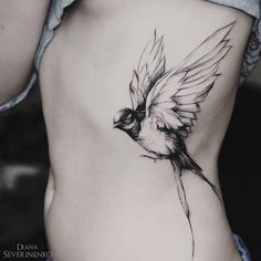 Pretty swallow in flight, girls side tattoo done with black ink in a sketch style. This lovely bird piece is by Diana Severinenko, an artist based in Kiev, Ukraine.