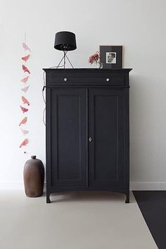 The flat paint trend isn't reserved just for walls—brush a coat of charcoal paint on an old piece of furniture to give it a fresh look, while also hiding nicks and scratches. The beautiful armoire above is from vtwonen.