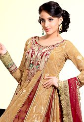 The traditional patterns used on this suit maintain the ethnic look. The dazzling fawn and maroon faux georgette churidar suit have amazing embroidery patch work is done with resham, zari, stone and lace work. The entire ensemble makes an excellent wear. Matching maroon santoon churidar and maroon faux chiffon dupatta is available with this suit. Slight Color variations are possible due to differing screen and photograph resolutions.
