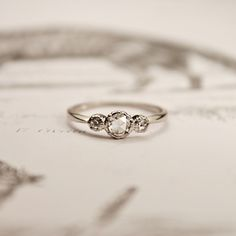 Platinum ring with rose-cut diamonds – ideal trilogy ring for a wedding ;)  £1,995.00