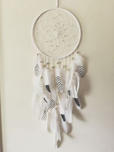 Feather dream catcher. Black dipped and stripped feathers add a bit of details to this simple classic dream catcher. Simple in design but certainly do wonders and adds much elegance to your home decor!