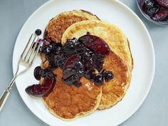 Greek Yogurt Pancakes Recipe - The perfect hybrid of flapjacks and crepes, these protein-packed pancakes are low in calories and fat. The blueberry-peach sauce is made without any added sugar, relying for sweetness on the natural sugars from the fruit and pineapple juice.