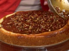 Get this all-star, easy-to-follow Aunt Peggy's Cheesecake with Praline Topping recipe from Paula Deen