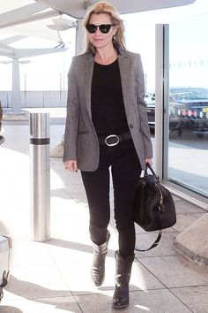 How To Make Your Stuffiest Blazer Cool, Courtesy Of Kate Moss  #refinery29  http://www.refinery29.com/2015/04/86131/kate-moss-blazer-outfit#slide-1  Kate Moss was spotted at the airport in London wearing black jeans and Isabel Marant boots with a boxy Stella McCartney tweed blazer, which we should all be so lucky to have in our wardrobes.
