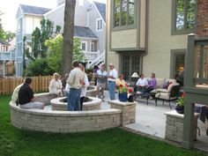 Party on a newly finished outdoor living space. Columns, seat walls, and a stamped concrete patio with brick edging. Deluxe!