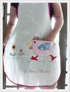 This has to be the cutest apron I have seen... that is not from a vintage pattern! It has a fantastic chicken stitched on the skirt...