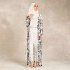 Minimal Eid Look: Infusing elegance, luxury and modesty for minimal perfection. The versatility of this outfit means you can wear this carefree look for a special occasion such as Eid or dressed for a summer season style. Take a peak at our many minimal inspired designs online.  White Crepe Top  Floral Print Straight Cut Kimono White Georgette Hijab  White Trousers to be released over the weekend.  www.inayahcollection.com