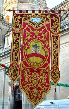 Banners decorating streets and houses during the feast of the town or village's Patron Saint, Malta