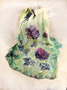 """Green silk chiffon scarf. Hand-painted black roses. Unique square shawl. Art to wear. Womens accessories. by Singing Silk Art to wear. Green chiffon silk scarf Black roses"""". Unique hand-painted square scarf with floral design.Size 70x70cm, 28x28"""".Original hand-painted silk square scarf Black roses"""" ¨C graphic flowers on soft and tender green watercolor background. It¡¯s a wearable art for the lady who prefers to be one-of-a-kind"""" .The shawl is hand-painted in combined technique - watercolor…"""