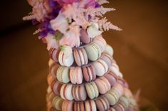 Macaron wedding tower with flowers. Handcrafted macarons made with natural colours and local and seasonal ingredients. Photo by Laura Calderwood. Flowers by Firenza Floral Design. From the Papakata Spring Open Weekend. #macaroons #Yorkshire #Lancashire #Cheshire #manchester