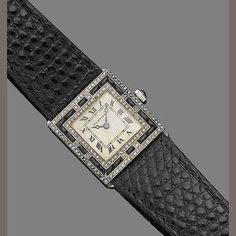 An art deco onyx and diamond wristwatch, by Cartier