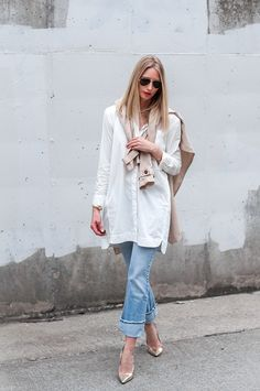 Spring style. Long white blouse, jeans, cute heels, and a trench coat. Love the layering in this outfit.