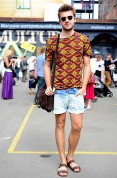 The styling cues here are inspirational for the modern sportswear guy. I love the way he tucks the T-shirt into the shorts--it doesn't feel forced at all. Interesting shoe choice--Birkenstocks are in! Those sandals are unexpected and fresh for summer.