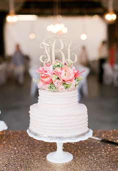 LOVE this wedding cake and monogram cake topper!