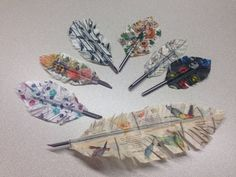 Washi tape feathers made on coffee stirrers