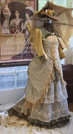 Silk lisere, silk taffeta, silk chifffon, and antique tambour lace a la mode 1878, with a hat stitched on my original 1877 Wilcox & Gibbs chainstitch treadle machine. A Lily Absinthe original, it was refashioned for my client and now has a new home.