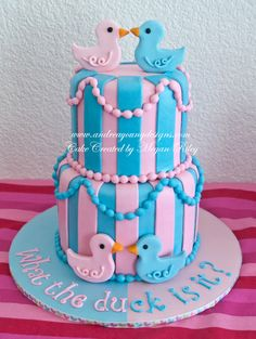 Gender Reveal cake made by Megan Riley off my custom invitation design the original first what the duck is it design. Sorry for the watermark but someone stole this image and was using it as their own design. gender reveal, ducks, pink and blue, cake.