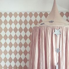 Numero74 dusty pink canopy, adorned with our silver grey falling garland #numero74 #girlroom #girlroomdecor