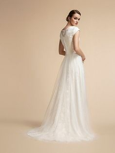 Moonlight Modesty is charming and beautiful with sparkly lace details and tulle overskirt. Wedding Dress Backs, Wedding Dress Sleeves, Modest Wedding Dresses, Dresses With Sleeves, Short Sleeves, Conservative Wedding Dress, Beaded Wedding Gowns, A Line Gown, Bridal Looks