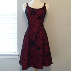 """Burgundy and Black Floral Cocktail Dress This beautiful cocktail dress is in LIKE NEW condition // worn less than a handful of times // black floral pattern made of velvet-like material // measures approx. 39.5"""" from shoulder to hem // bust measures 16"""" across armpits // no holes, stains or imperfections // comes from a smoke free environment Bundles welcome Offers welcome ❌NO trades, please. ⚡️Same/Next day shipping K Studio Dresses"""