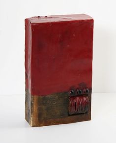 "Kim Bruce, 2011  Wax Seal (back view)  Encaustic and found objects  7"" x 4"" x 1.5"" #bookart"