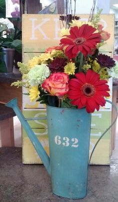 Summer arrangement in watering can by Superior Hy-Vee