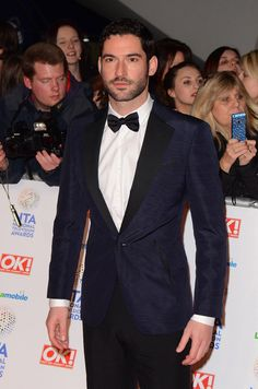 Tom Ellis wearing a Ferragamo men's midnight blue tuxedo at the National TV Awards in London.