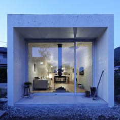 The house was constructed without discrete rooms, inviting its occupants to define interior spaces and level of privacy through the placement of furniture. Once furnished, the building is complete.