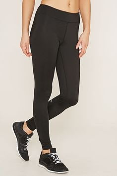 """A pair of athletic leggings crafted from stretch knit with a back """"Get Moving"""" graphic, moisture management, and a hidden key pocket."""