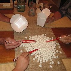 Minute to Win It Game:  How many mini marshmallows can you pick up with chopsticks? ... Or could use pom-poms or beans... Veggies might prefer that as I'm sure the non-veggies would be munching the marshmallows!