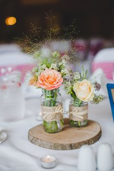 Vintage burlap wrapped mason jar centerpiece with wooden trunk stand