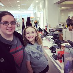 Monkey introducing her older sister to the joys of make-up... (For over $450... I hope it's lasting joy!)