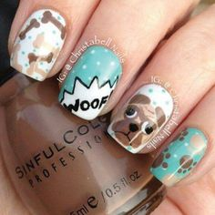 """Instagram-user @christabellnails posted these furry-friendly nails. This manicure makes a statement with doggie bones, a pug face, paw prints and the word """"Woof"""". We recommend wearing these nails at your next dog show, or really any time you want to show your love for man's best friend."""