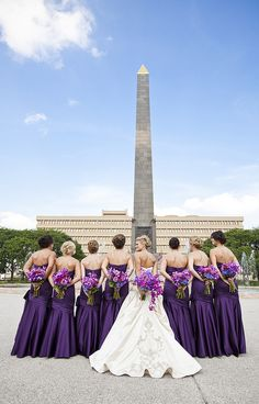 purple bridesmaids dresses and flowers