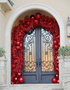 This impressive display requires quite a few ornaments (to put it mildly). If you don't have a few hundred matching red balls, a small take can look just as lovely.