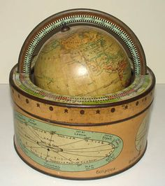 4-inch Terrestrial Table Globe (Aardglobe)  J.B. Wolters, Groningen, Netherlands: Early 20th Century  Tin drum stand  6.5 inches high, 6 inches diameter