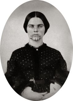 Olive Oatman's family was attacked by Indians as they were travelling by wagon in1850. Olive, then 13, and her younger sister Mary were brought to a village as slaves. A year later Olive and her sister were traded to a more prosperous Mohave tribe. The girls were both tattooed on their chins and arms in keeping with the tribal custom.  Olive's younger sister Mary died at the age of 10. Olive was 19 when was finally traded for blankets and horses and released to an Army outpost.