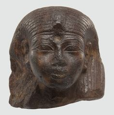 From the time of Amenhotep III. The figurine is made of red quartzite. The colour was probably associated with the rising sun, considering that around this time, the cult of the all-powerful sun god was on the rise. It would reach its height during the reign of Akhenaten. On the forehead of this figurine, there was originally a cobra head, a symbol of power worn by both gods and pharaohs. If you want to know more, clickon the image.   Rijksmuseum van Oudheden