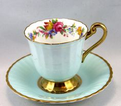 Beautiful, Chocolate Paragon Cup & Saucer, Delicate Floral Pattern, Sky Blue Borders, Gold Rims, Bone English China made in 1950s. In good condition, no chips, cracks, crazing or repairs. The Saucer measures-4.7`inch (12cm) in diameter. The Cup opening-2.6 (6.5cm), with the Handle-3.7