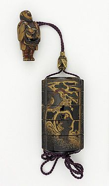 Japan, 17th century Costumes; Accessories Four-case inrō with design of two Chinese sages in inlaid tortoiseshell on gold fundame, gold takamakie over black lacquer; metal badger as priest ojime; wood netsuke of man with mokugyo drum (2)