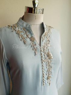 This feminine and chic powder Blue Georgette Kurta features a hand embroidered silver zardosi neckline and potli buttons to enhance the Embroidery On Kurtis, Kurti Embroidery Design, Embroidery Suits, Zardozi Embroidery, Off White Pants, White Trousers, Gala Design, Work Sarees, Chiffon Saree