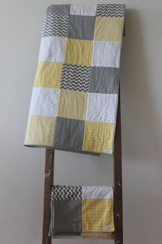 Modern gender neutral baby quilt with three matching burping cloths. Yellow, grey and white; polkadot, chevron, stripe and houndstooth